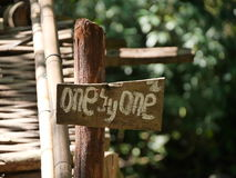 wooden sign saying one by one Stock Photo