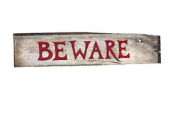 Wooden sign that says beware Stock Photo