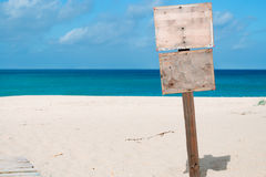 Wooden sign at the beach Royalty Free Stock Photos