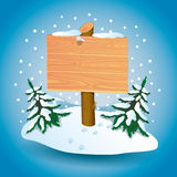 Wooden sign on snow. Stock Photography