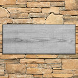 Wooden sign on the stone wall. Stock Photography