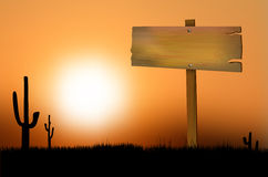 Wooden sign at sunset on the prairie Stock Photo