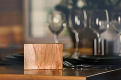 Wooden sign on table. In cafe stock photography