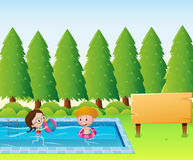 Wooden sign template with kids in the pool Royalty Free Stock Photo