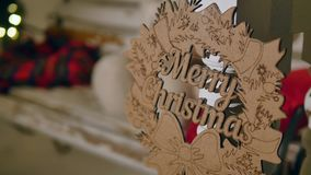 Wooden sign with text Merry christmas on the background of Christmas lights Royalty Free Stock Image