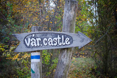 Wooden sign to the castle in Hungary in autumn park Stock Photo
