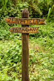 Wooden Sign to Playfield and Faraway Royalty Free Stock Photos
