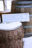 Wooden sign on tree stump with the word Beach royalty free stock image