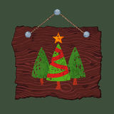 Wooden Sign with Trees. Dark wooden sign with painted Christmas trees for sale Royalty Free Stock Images