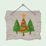 Wooden Sign with Trees. Gray wooden sign with painted Christmas trees for sale Stock Photography