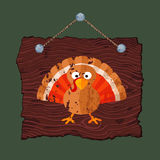 Wooden Sign with Turkey. Dark brown hanging wooden sign with painted grunge pumpkin Royalty Free Stock Photos