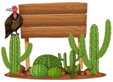 Wooden sign and vulture in cactus garden Royalty Free Stock Images