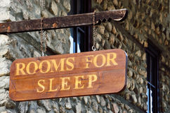 Wooden sign on the wall of a motel Stock Image