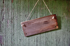 Wooden sign on wathered barn wall.  Stock Image