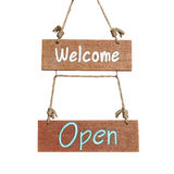 Wooden sign with welcome and open word Stock Photo