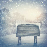 Wooden sign. In winter forest royalty free stock image