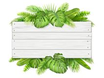 Wooden Sign With Tropical Leaves Stock Photo