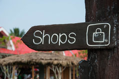 Wooden signage indicating shopping area Royalty Free Stock Photo