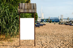 Wooden signboard background on the beach Royalty Free Stock Image