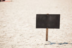Wooden signboard on beach Stock Images