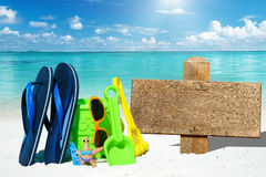 Wooden signboard and beach toys Stock Photo