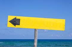 Wooden signboard on the beach Stock Images