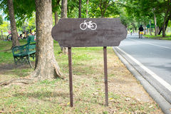 Wooden signboard with bicycle symbol Stock Image