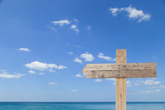 wooden signboard on blue sky for summer background with copy spa Royalty Free Stock Photography