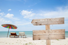 Wooden signboard on blue sky , tropical beach for summer backgro Stock Image