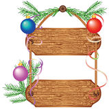 Wooden signboard with Christmas decorations Stock Photo