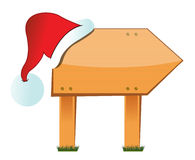 Wooden signboard with christmas hat Royalty Free Stock Photo