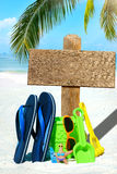 Wooden signboard and flip flops Stock Images