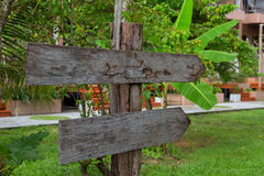 Wooden signboard in the forest Royalty Free Stock Photos