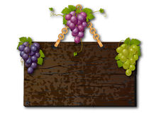 Wooden signboard with grapes Royalty Free Stock Photography