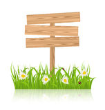 Wooden signboard for guidepost with field green grass and camomi Stock Photo