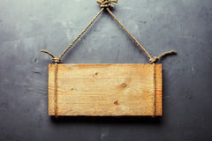Wooden signboard hanging on rope Stock Images