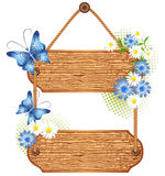 Wooden signboard with meadow flowers Stock Images