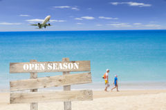 Wooden signboard (open season) on blur beach for summer backgrou Royalty Free Stock Photography