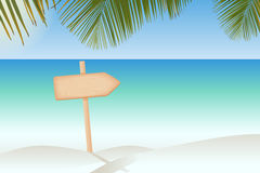Wooden signboard on a pole at the tropical beach Stock Images