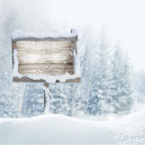Wooden signboard in snow .Christmas banner. Royalty Free Stock Photos