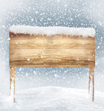 Wooden signboard in snow Royalty Free Stock Photos