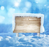 Wooden signboard in snow Stock Image