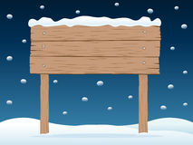 wooden signboard in snowy night Stock Images