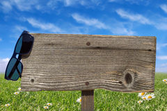 Wooden signboard on summer meadow Royalty Free Stock Photo