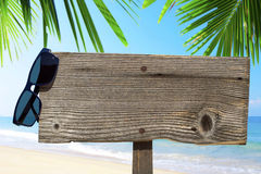 Wooden signboard and sunglasses Stock Images
