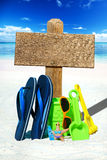 Wooden signboard on the sunny beach Royalty Free Stock Photo