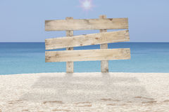 Wooden signboard on tropical beach for summer background. Stock Image