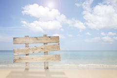 Wooden signboard on tropical beach for summer background. Royalty Free Stock Images
