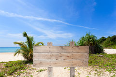 wooden signboard on tropical beach for summer background. Royalty Free Stock Photography
