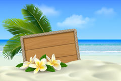 Wooden signboard on tropical beach with white sand, plumeria flowers and palm leaves. Summer background with place for text Stock Images